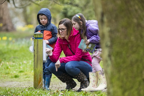 Visitors on an Easter egg hunt at Winkworth Arboretum