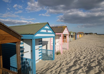 Coastal West Sussex beach huts and sandy beach
