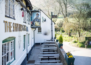 The Shepherd & Dog country pub in Fulking with picnic benches outside