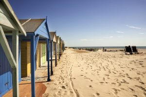 Beach huts on a beautiful sandy beach on the South of England