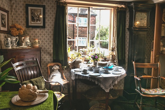 Table laid with china in old fashioned room at the Petworth Cottage Museum