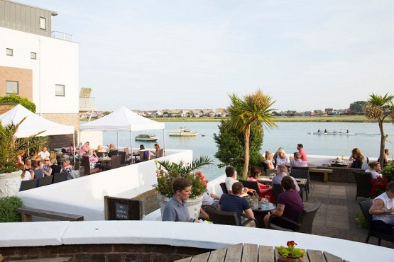 People enjoying food and drink on a summer evening in West Sussex
