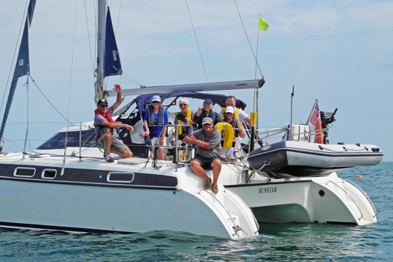 A group enjoying a skippered charter from Chichester Sailing around Chichester Harbour
