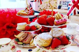 British afternoon tea with sandwiches, scones, fruit and cakes at Pretty Things in Horsham