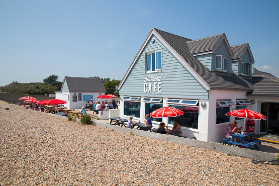The outside of Bluebird Cafe next to Worthing beach