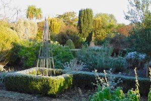 Denmans Garden shadowed with sunlight