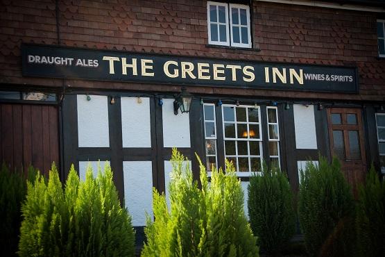 Outside sign of The Greets Inn in Warnhum