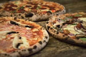 Three wood-fired oven pizzas at The Real Pizza Company in Copthorne
