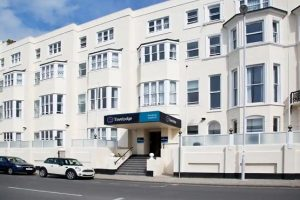 Road and front entrance of Travelodge Worthing Seafront