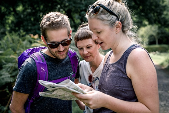 A group of hikers reading a map in a rural setting