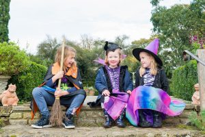 Three children dressed up as witches