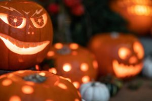 Carved out Halloween pumpkins lit with candles
