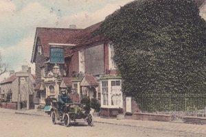 An old image of Henfield with a horse and carriage