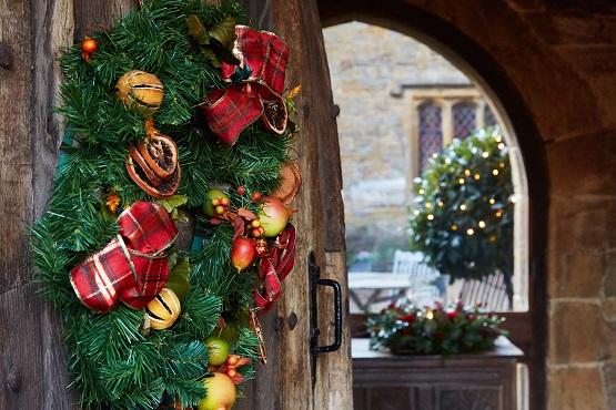 Christmas wreath hanging on a garden entrance door
