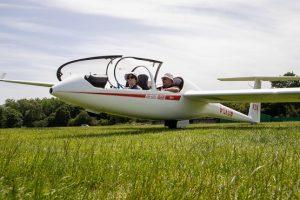 Two passengers in a plane at the Southdown Gliding Club