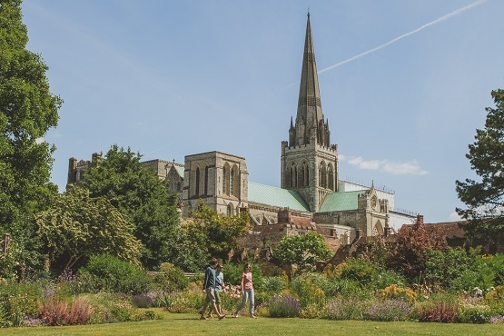 Chichester Cathedral pictured through a garden landscape