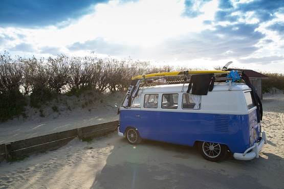 Campervan parked at a sandy beach