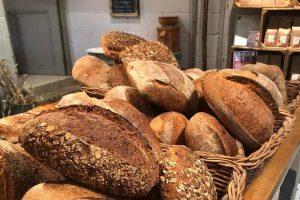 Basket full of baked breads at Artisan Bakehouse