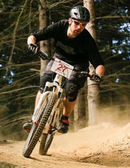 A man mountain biking in West Sussex