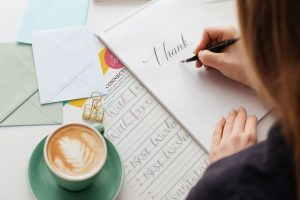 Calligraphy writing papers with a coffee