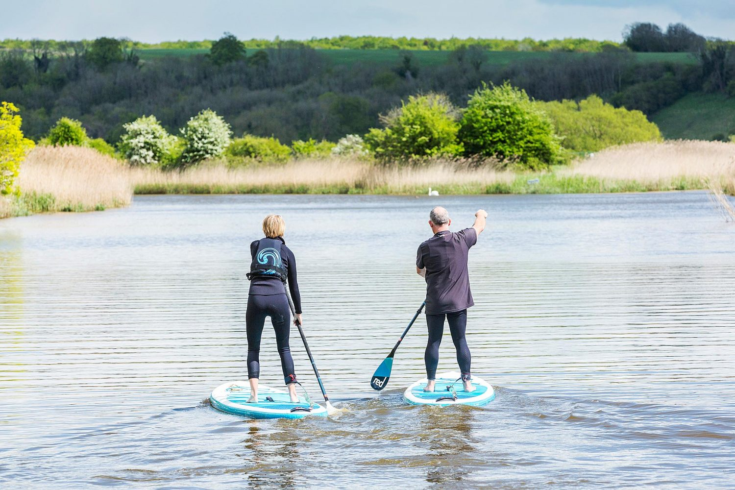 Two paddle boarders in a river