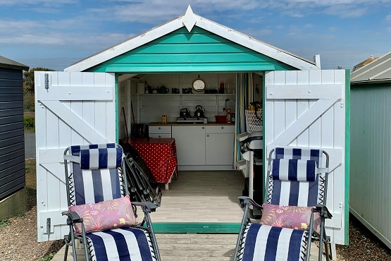 Sussex Beach Hut with two sun loungers in front