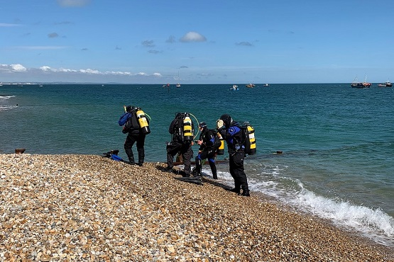 Marine conservationists getting out of the water in West Sussex