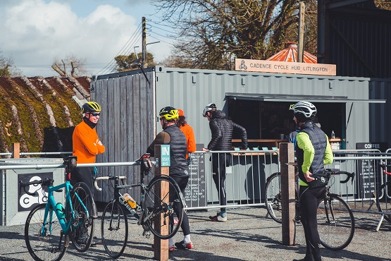 A group of cyclists queuing at Cadence Cycle Club's Hub