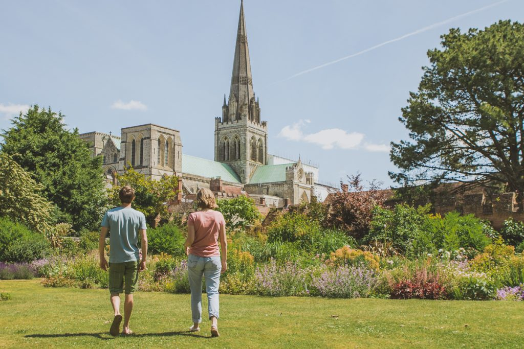 A couple walking towards Chichester Cathedral